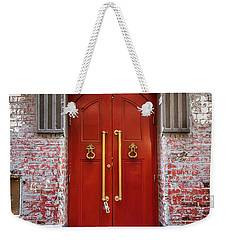 Weekender Tote Bag featuring the photograph Big Red Doors by Perry Webster