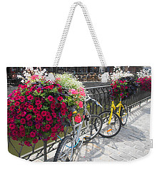 Weekender Tote Bag featuring the photograph Bike And Flowers by Therese Alcorn