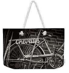 Weekender Tote Bag featuring the photograph Bike Over Chevelles by Greg Mimbs