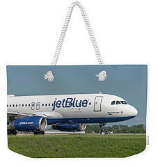 Weekender Tote Bag featuring the photograph Bippity Boppity Blue by Guy Whiteley