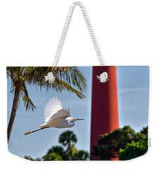 Bird In Flight Under Jupiter Lighthouse, Florida Weekender Tote Bag