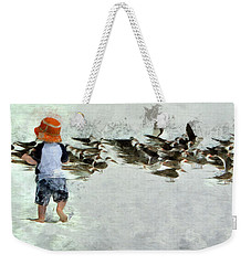 Weekender Tote Bag featuring the photograph Bird Play by Claire Bull