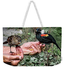 Weekender Tote Bag featuring the photograph Birds In The Hands by Jennie Breeze