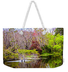 Weekender Tote Bag featuring the photograph Birds Playing In The Pond 3 by Madeline Ellis