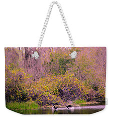 Weekender Tote Bag featuring the photograph Birds Playing In The Pond 2 by Madeline Ellis