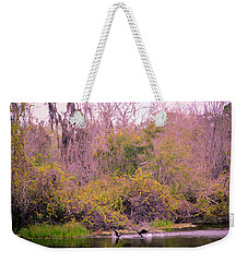 Weekender Tote Bag featuring the photograph Birds Playing In The Pond 1 by Madeline Ellis