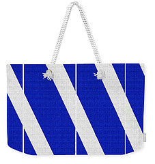 Weekender Tote Bag featuring the photograph Blue And White Abstract by Tom Janca
