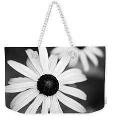 Weekender Tote Bag featuring the photograph Black And White Daisies by Christina Rollo
