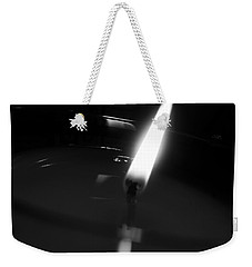 Weekender Tote Bag featuring the photograph Black And White Flame by Robert Knight