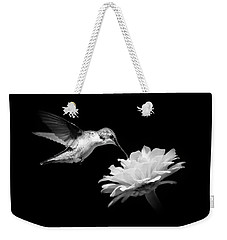 Weekender Tote Bag featuring the photograph Black And White Hummingbird And Flower by Christina Rollo