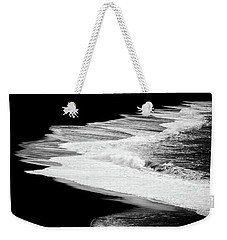 Weekender Tote Bag featuring the photograph Black Beach And The Water Of The Ocean by Matthias Hauser