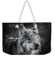 Weekender Tote Bag featuring the photograph Black N White Wolf by Elaine Malott