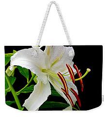 Blackdrop Behind White Lily Weekender Tote Bag by Marsha Heiken