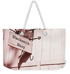 Weekender Tote Bag featuring the photograph Blacksmith Shop by Alexey Stiop