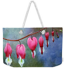 Weekender Tote Bag featuring the photograph Bleeding Heart 2 by Marilyn Hunt