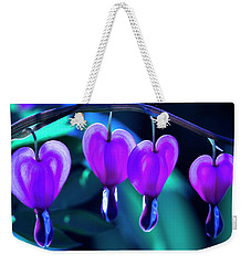 Weekender Tote Bag featuring the photograph Bleeding Hearts In Moon Light by Skip Tribby