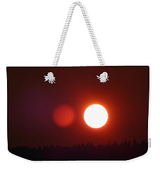 Weekender Tote Bag featuring the photograph Blood Red Sunset by Will Borden