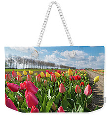 Weekender Tote Bag featuring the photograph Blooming Holland Tulips by Hans Engbers