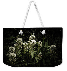 Weekender Tote Bag featuring the photograph Blooming In The Shadows by Marco Oliveira