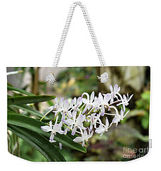 Weekender Tote Bag featuring the photograph Blooming White Flower Spike by James Fannin