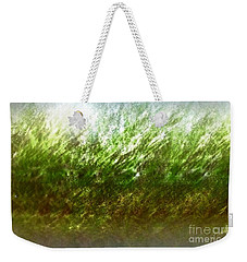 Weekender Tote Bag featuring the photograph Blowing In The Wind by John Krakora