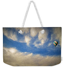 Weekender Tote Bag featuring the photograph Blown Into A Soft Sky by Glenn McCarthy Art and Photography
