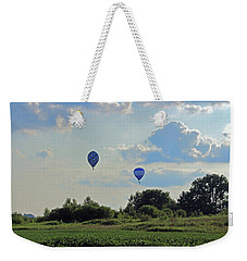 Weekender Tote Bag featuring the photograph Blue Balloons Over A Field by Angela Murdock