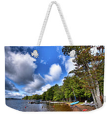 Weekender Tote Bag featuring the photograph Blue Boat On The Shore by David Patterson
