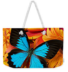 Blue Butterfly On Brightly Colored Flowers Weekender Tote Bag by Garry Gay