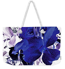 Weekender Tote Bag featuring the photograph Blue Canna Lily by Shawna Rowe