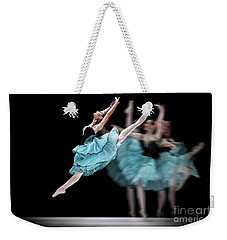 Weekender Tote Bag featuring the photograph Blue Dress Dance by Dimitar Hristov
