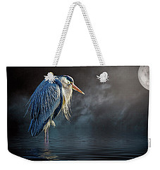 Weekender Tote Bag featuring the photograph Blue Heron Moon by Brian Tarr
