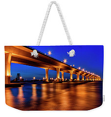 Weekender Tote Bag featuring the photograph Blue Hour At Roosevelt Bridge In Stuart Florida  by Justin Kelefas