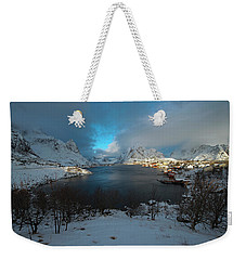 Weekender Tote Bag featuring the photograph Blue Hour Over Reine by Dubi Roman