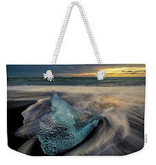 Weekender Tote Bag featuring the photograph Blue Ice Stranding by Rikk Flohr