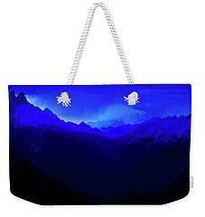 Weekender Tote Bag featuring the photograph Blue by John Poon