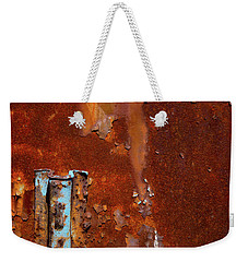 Weekender Tote Bag featuring the photograph Blue On Rust by Karol Livote