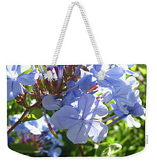 Weekender Tote Bag featuring the photograph Blue Plumbago by Mary Ellen Frazee