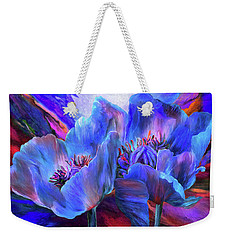Weekender Tote Bag featuring the mixed media Blue Poppies On Red by Carol Cavalaris