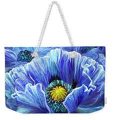 Weekender Tote Bag featuring the mixed media Blue Poppy Splash by Carol Cavalaris