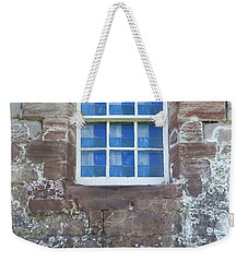 Weekender Tote Bag featuring the photograph Blue Squares In The Castle Window by Christi Kraft