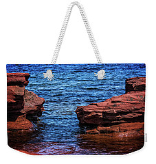 Weekender Tote Bag featuring the photograph Blue Water Between Red Stone by Chris Bordeleau