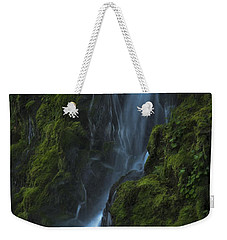 Weekender Tote Bag featuring the photograph Blue Waterfall by Yulia Kazansky