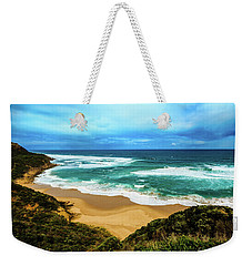 Weekender Tote Bag featuring the photograph Blue Wave Beach by Perry Webster