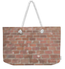 Weekender Tote Bag featuring the photograph Blurred Orange Brick Wall,floor Exterior,interior Pattern Design by Jingjits Photography