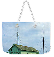 Weekender Tote Bag featuring the photograph Boat By Oyster Shack by Susan Savad