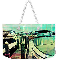 Weekender Tote Bag featuring the photograph Boats And Dock by Susan Stone