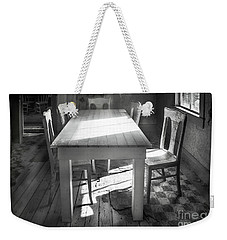 Weekender Tote Bag featuring the photograph Bodie Breakfast Table by Craig J Satterlee