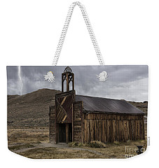 Weekender Tote Bag featuring the photograph Bodie Fire Station With Lightning by Sandra Bronstein