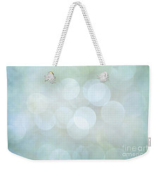Weekender Tote Bag featuring the photograph Bokeh Clouds by Jan Bickerton
